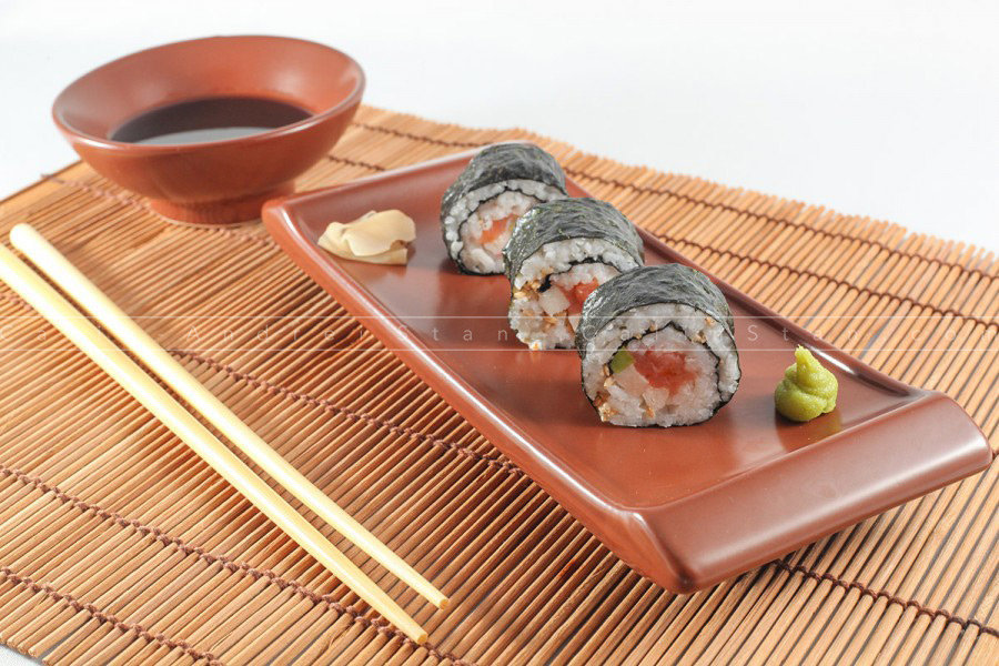 Maki delicious sushi rolls with chopsticks, soy sauce and wasabi