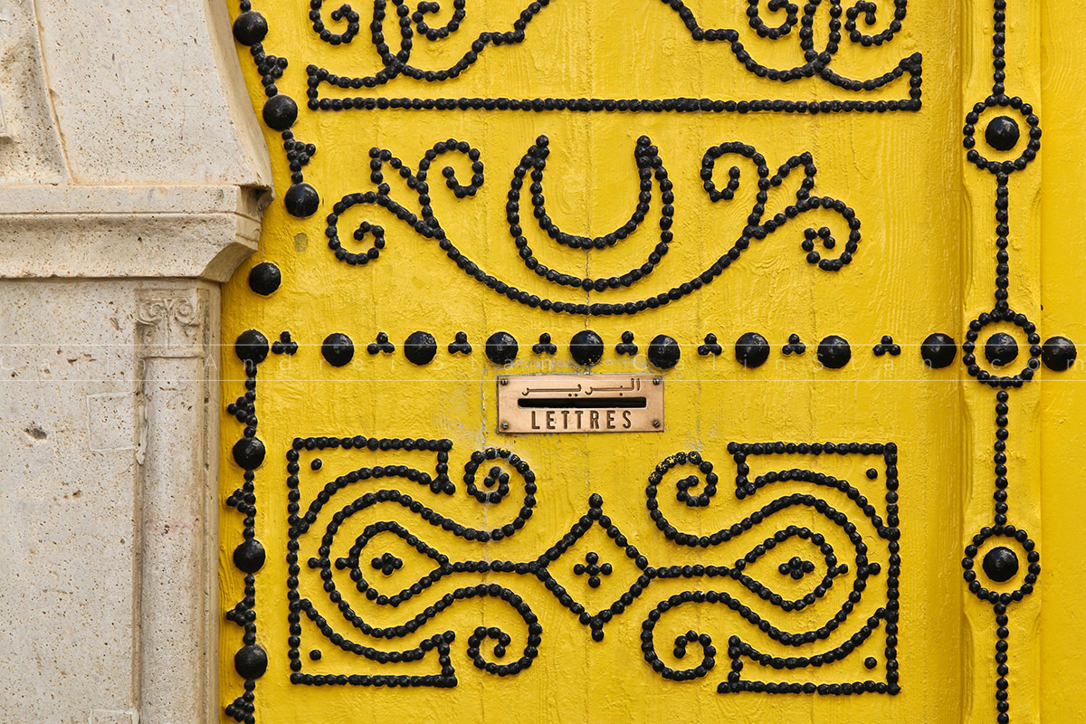 Beautifull traditional yello door of Tunisia with black ornament