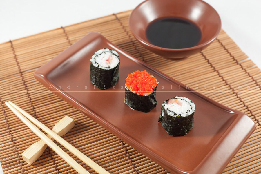 Sushi menu with Soy Saouce and Chopsticks, on traditional wood background